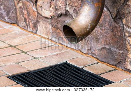 Gutter Downspout On The Wall Of House. Metal Rain Downspout At Home Exterior. Spout Of Gutter Pipe A
