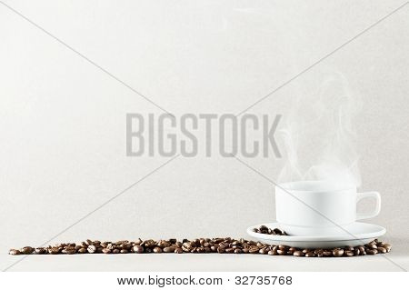 white coffee cup on white background with coffee beans