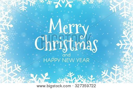 Merry Christmas Blue Background. Happy New Year Concept With Blurred Snow Flakes. Xmas Greeting Card