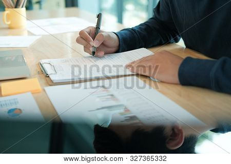 Candidate Applicant Fill Out Application Form. Man Signing Contract Agreement. Employment Recruitmen