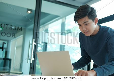 Startup Male Freelancer Working With Computer At Office. Man Entrepreneur Analyzing Financial Perfor