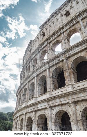 Rome, Italy - October 3, 2019: Exterior View Of The Ancient Colosseum Or Coliseum, Also Known As Fla