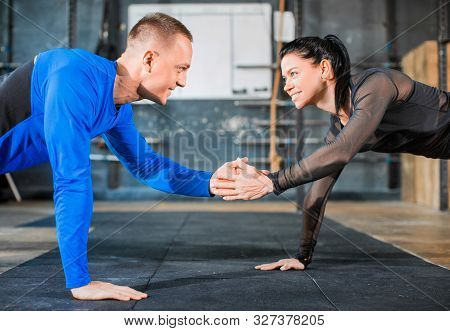 Push-ups Together. Healthy Couple In Gym, Workout With Own Body Weight. Close Ip Photo. Active And S