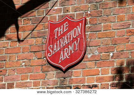 New York City, 9/27/2019: The Salvation Army Shield Is Mounted To An Exterior Brick Wall Above The E