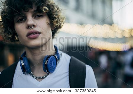 Stylish Young Man With Headphones Outdoors Stock Photo