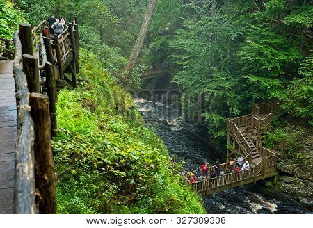 Bushkill Falls, Pa, Usa - September 3, 2018: Visitors Take In The Scenic Sights From The Walkways An