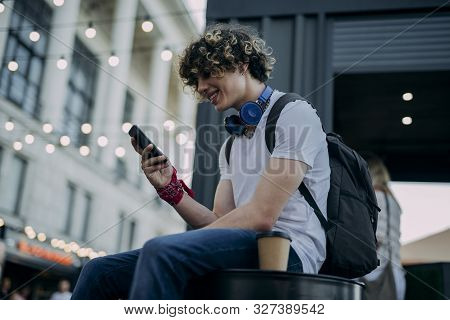 Happy Guy Wondering With Coffee And Smartphone Stock Photo