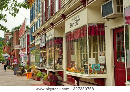 Cooperstown, Ny - September 8, 2018: Shops, Eateries, And Baseball-themed Attractions Line The Sidew