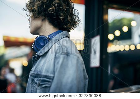 Curly Young Guy Walking In City Stock Photo