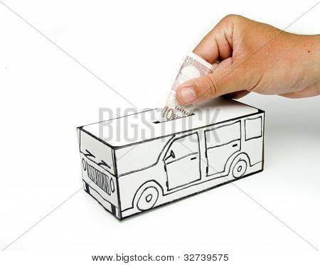 Safe design with car and ten euro note