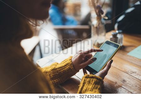 Girl Hold In Hands Yellow Mobile Phone, Person Type Message On Empty Screen Smartphone In Sun Cafe,