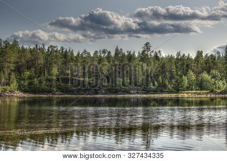 Hdr Shot With Tone Mapping Effect At The Stream Skelleftealven In Vasterbotten, Sweden