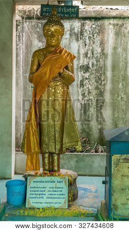 Bang Saen, Thailand - March 16, 2019: Wang Saensuk Buddhist Monastery. Gilded Buddha Image Statue Re