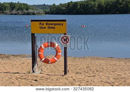 A Life Preserver Is Available For Emergency Usage At A Swimming Beach Without A Life Guard