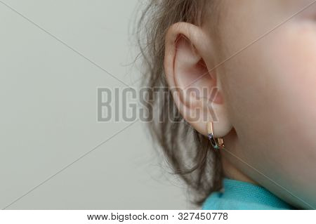 the puncture of ears to children is younger than three years poster
