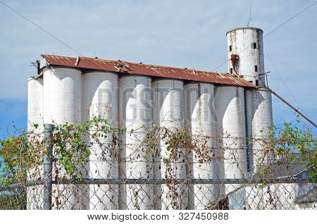 Fitzgerald, Georgia - October 12, 2019 An Old Defunct Grain Storage Facility Stands Out In A Commerc