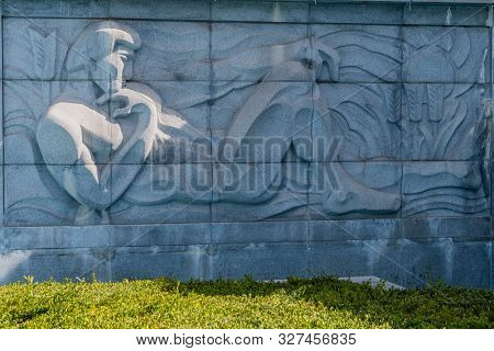 Daejeon, South Korea; October 9, 2019: Bas-relief Of Man Relaxing In Garden On Side Of Statue Of Ten