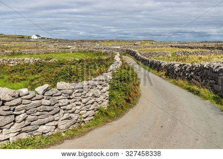 Road With Rock Walls And Farm Fields Around In Inisheer Island