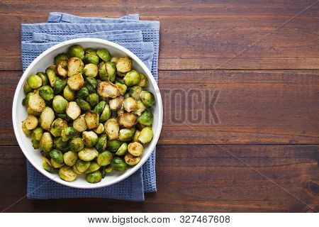Fresh Homemade Roasted Brussels Sprouts In White Bowl, Photographed Overhead With Copy Space On The