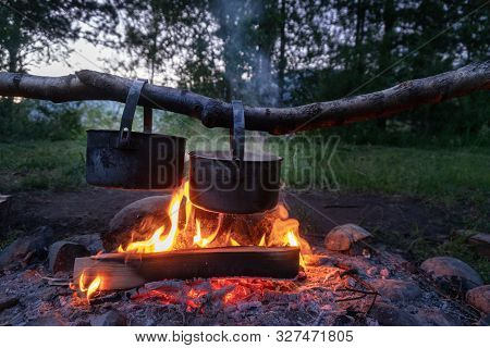 Cooking Dinner At The Campfire. Camping Food.