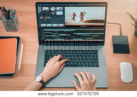 Concept Of Simple Operation Of Blogger And Vlogger, Hand Using Laptop On Video Editor Works With Foo