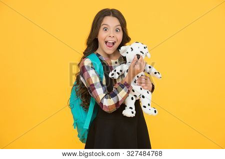 Cuddly Friend. Happy Little Child Hold Toy Dog Yellow Background. Small Girl Smile With Soft Toy Fri
