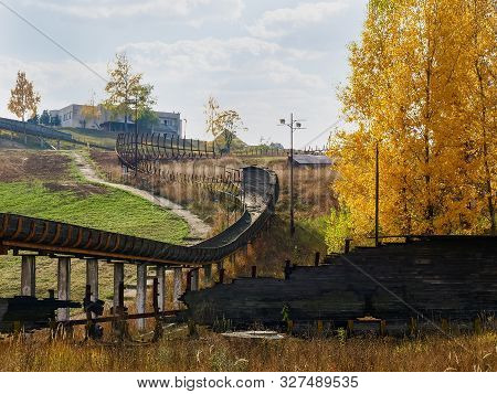 Ruins Of The Old Abandoned Luge Track Made With Steel Framework And Wooden Chute Covering In Autumn,