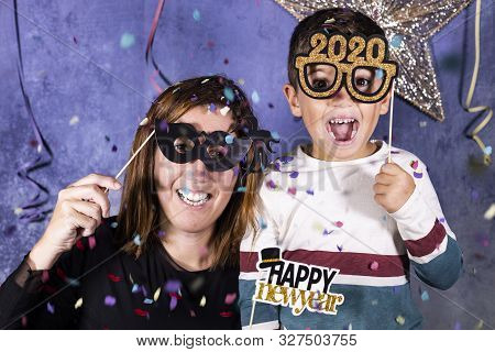 Mother And Son Celebrating New Years Eve At Home