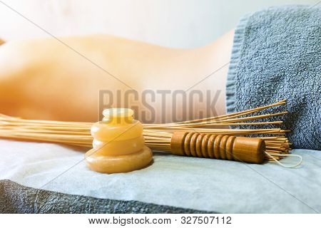 Massage Accessories. Stone Yellow Jade And Bamboo Beaters For Massage On The Background Of Recumbent