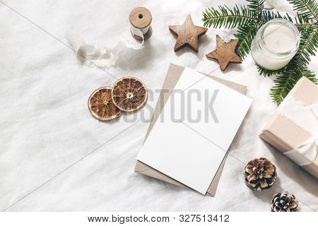 Christmas Blank Greeting Card Mock-up Scene. Festive Winter Wedding Composition. Craft Envelope, Pin