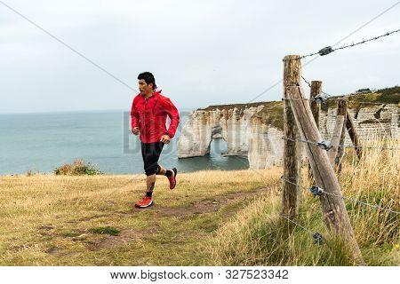 Etretat, Seine-maritime / France - 14 August 2019:  Asian Man Trail Runner Jogging On The Normandy C