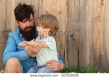 Help. Father And Son With Wound On The Arm. Abrasion, Bruising And Injuries. Summer In Nature. Fathe
