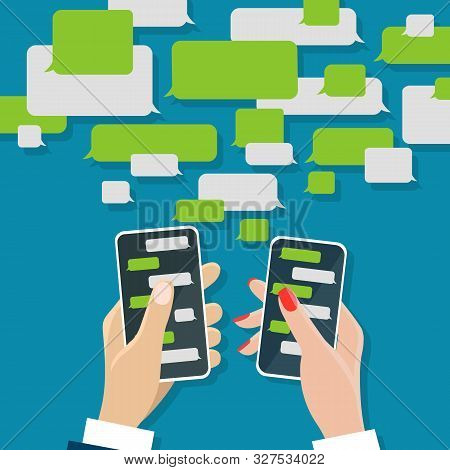 Chating Concept. Whatsapp Messaging Chat On Mobile Screens In Male And Female Hands, Cell Chats Mess