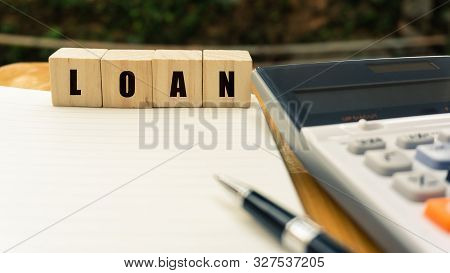 Business loan agreement concept background with blank notebook, calculator and pen. poster