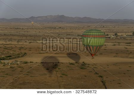 Hot Air Balloons Over Desert Pastureland Of Morocco