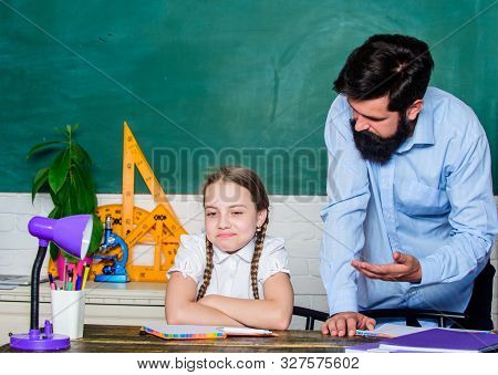 Strict pedagogue. Doing hometask paperwork. Tired kid unmotivated study learn. Private lesson. Homeschooling with father. Pedagogue skills. School teacher and schoolgirl. Man bearded pedagogue poster
