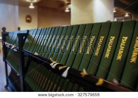 Porvoo, Finland - 2 October 2019: Closeup Of A Row Of Green Hymn Books On Swedish Language In Porvoo