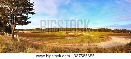 Beautiful Panorama Of A Golden Autmun Landscape With Trees And A Blue Sky