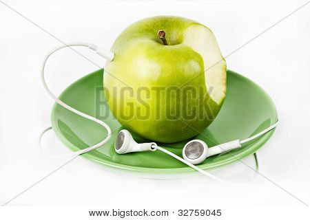 Green Apple with Headphones on green plate isolated on white background poster
