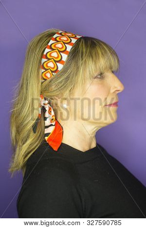Middleaged Woman With Blond Hair. Handkerchief To Decorate The Head