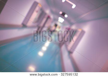 Long Hallway Of A Hospital Building, Unfocused Background.