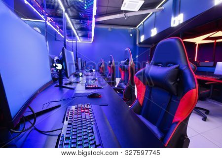 Professional Gamers Cafe Room With Powerful Personal Computer Game Chair Blue Color. Concept Cyber S