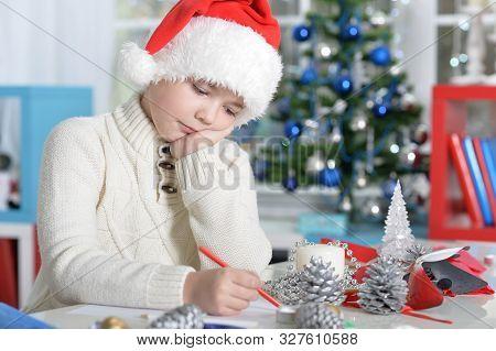 Close Up Portrait Of Little Boy Writing Letter