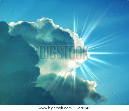 Sun Shining Behind A Dark Cloud
