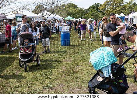 Babylon, New York, Usa - 8 September 2019: Families Enjoying A Sunny Day Walking And Pushing Strolle
