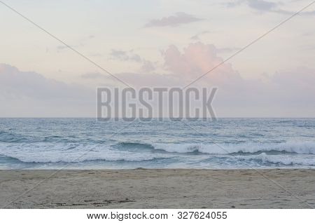 Peaceful beginning of sunset on a lonely beach, a cloudy afternoon, in Tayrona National Park, Colombia