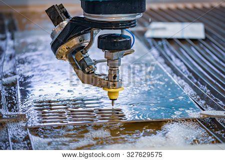 CNC water jet cutting machine modern industrial technology.