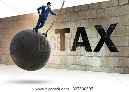 Businessman in tax return submission concept