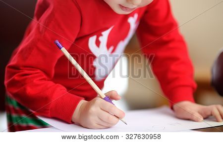 Little Boy Writing The Letter To Santa. Child Dreams Of A Gift That He Can Receive. Magic Mail Of Sa