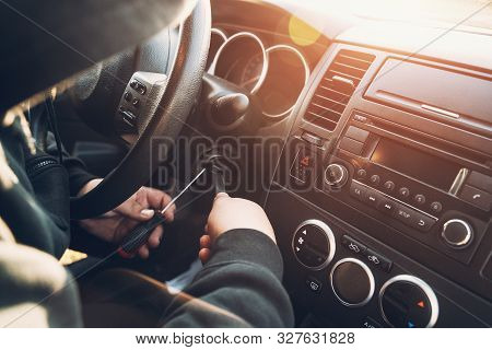 Criminal In Hood Trying To Break And Start Car, Car Theft Concept, Toned